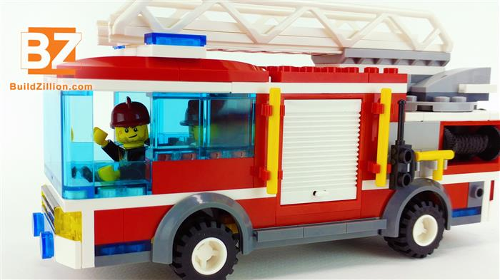 Lego fireman waving in the fire truck