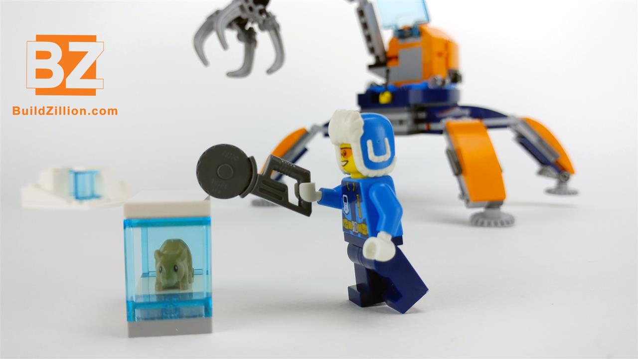 LEGO minifigure trying to cut throw the ice block with the frozen rodent